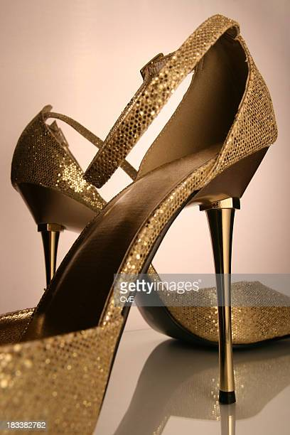 golden highheels - gold shoe stock pictures, royalty-free photos & images