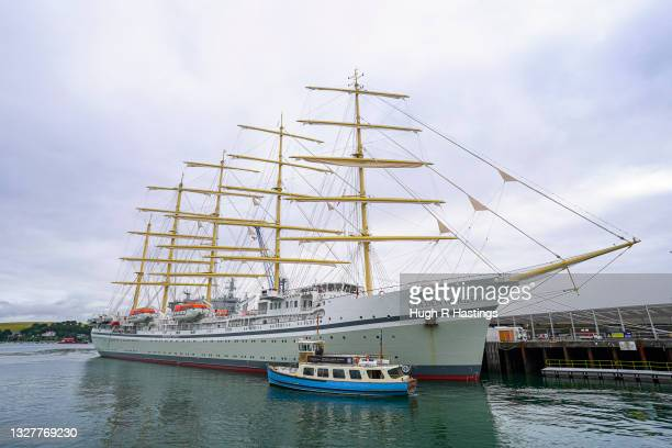 Golden Horizon, the world's largest square-rigged sailing vessel at 2,000 tonnes and over 160m in length, dwarfs a local ferry boat while moored on...