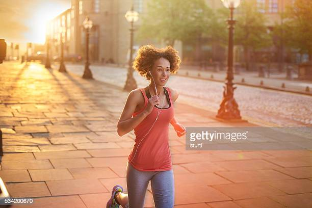 golden hour jogger - liverpool training stock pictures, royalty-free photos & images