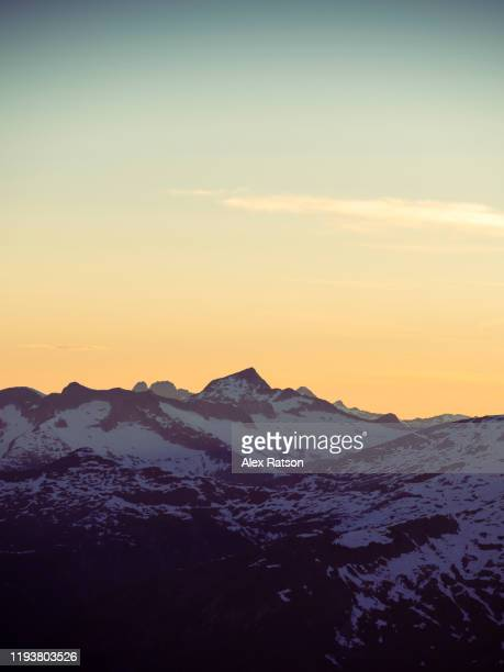 golden hour over british columbia's coast mountains - canada stock pictures, royalty-free photos & images