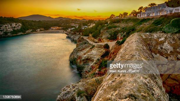golden hour sunset sea view at the beach cala romantica - manacor stock pictures, royalty-free photos & images