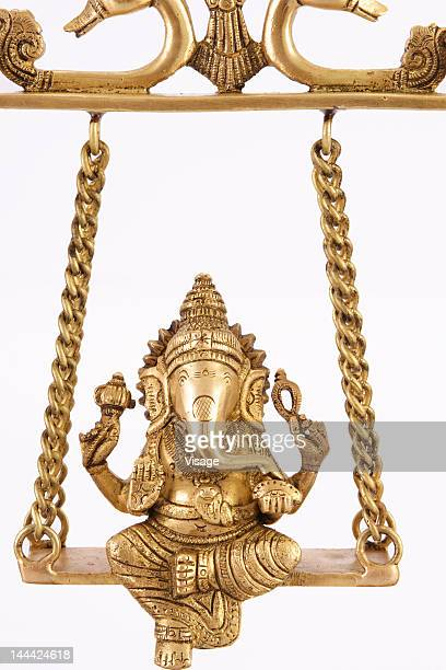 a golden idol of lord ganesh - hindu god stock photos and pictures