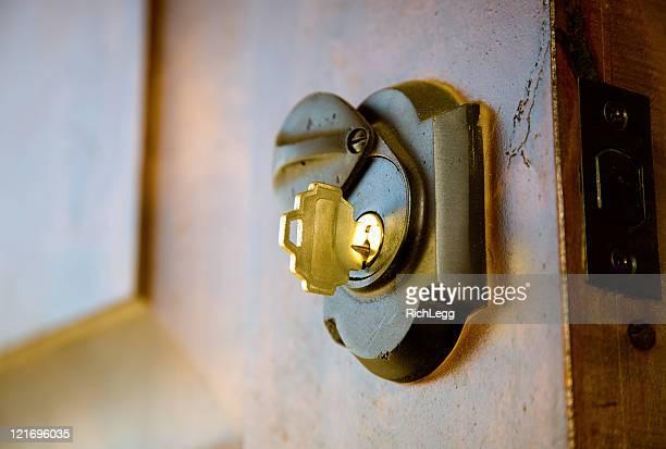 Golden Key in Deadbolt Lock