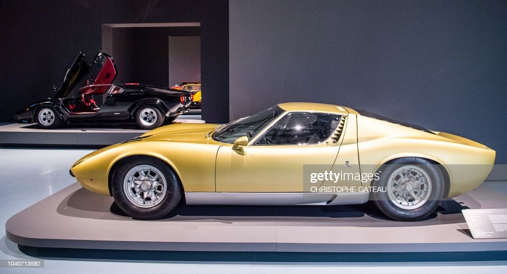 A Golden Lamborghini Miura P400 And A Lamborghini Countach 5000 Qv