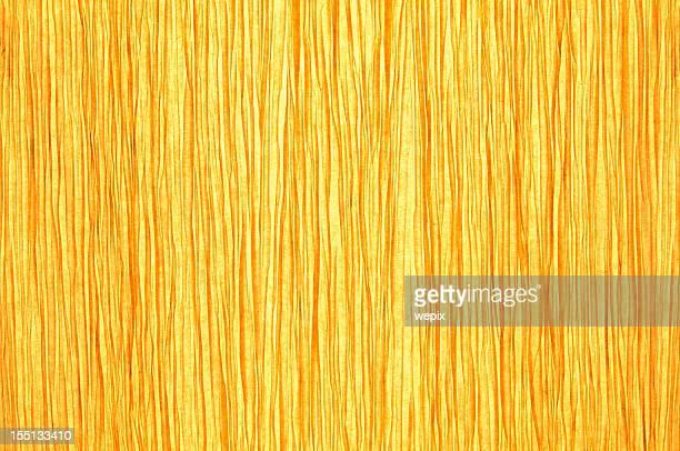紙の質感にゴールドの光輝くイエローの背景