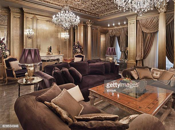Golden luxury living room in the private house