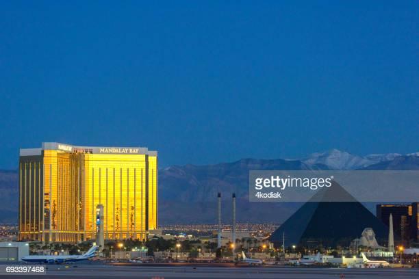 golden mandalay bay casino building at dawn at las vegas  nevada - mccarran international airport stock photos and pictures
