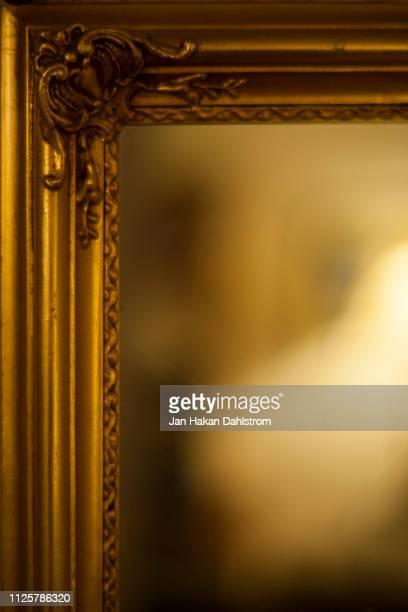 golden mirror frame - mirror frame stock photos and pictures