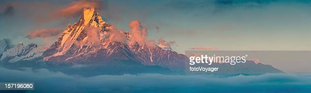 Golden mountain sunset Machapuchare sacred Himalaya peak