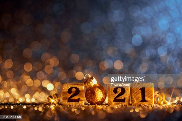 golden new year 2021 christmas decoration - blue party celebration wood cube - new year's eve stock pictures, royalty-free photos & images