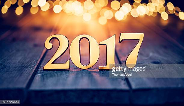 golden numbers 2017 - christmas lights wood new year gold - 2017 stock pictures, royalty-free photos & images
