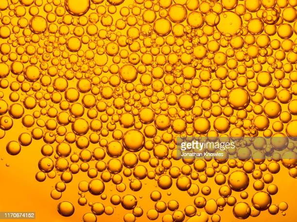 golden oil bubbles - cooking oil stock pictures, royalty-free photos & images