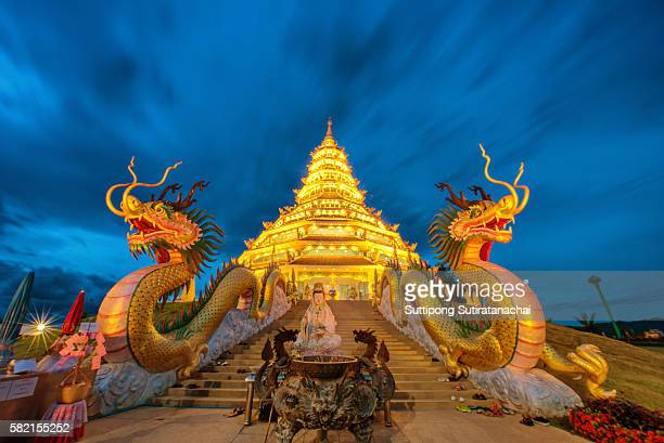 Golden Pagoda nine tier with dragon texture at Chinese temple - wat hyua pla kang , Chiang Rai,northern of Thailand