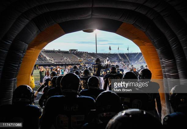Golden Panthers are introduced prior to the game against the New Hampshire Wildcats at Ricardo Silva Stadium on September 14 2019 in Miami Florida