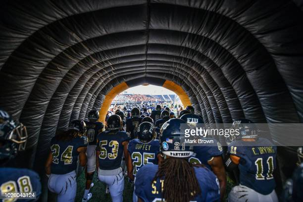 Golden Panthers run through the tunnel before the game against the Indiana Hoosiers at Ricardo Silva Stadium on September 1 2018 in Miami Florida