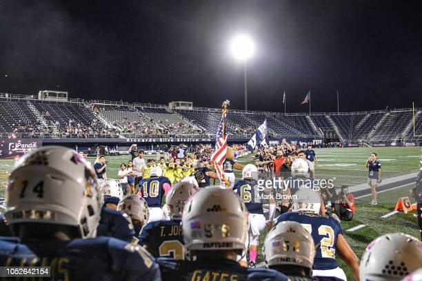 Golden Panthers take the field before the game against the at Ricardo Silva Stadium on October 20 2018 in Miami Florida