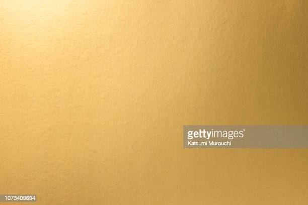 golden paper texture background - gold stock pictures, royalty-free photos & images