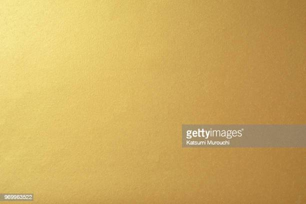 golden paper texture background - gold coloured stock pictures, royalty-free photos & images