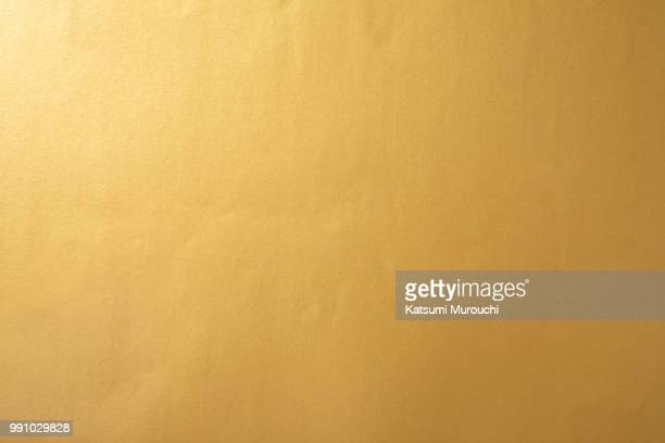 golden paper texture background - gilded stock pictures, royalty-free photos & images