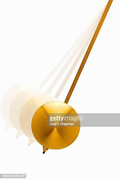 Golden pendulum swinging