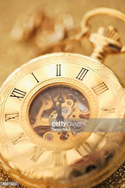 Golden pocket watch, close up