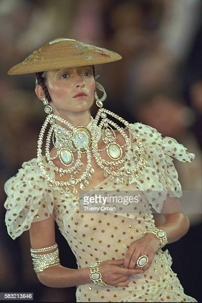 Golden polkadot dress and a Chinese straw hat worn by Audrey Marney