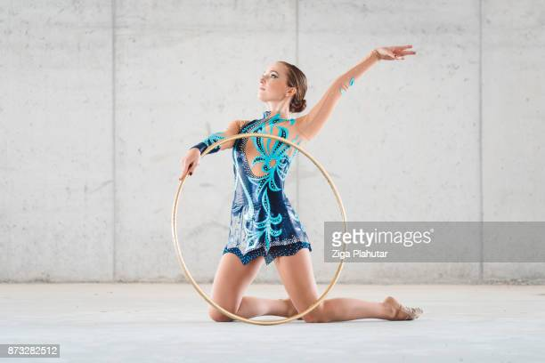 golden position - show girl stock photos and pictures