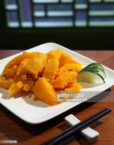 Golden pumpkin cooked with salted egg yolks at Hakka Ye Ye restaurant in Causeway Bay 01MAR11