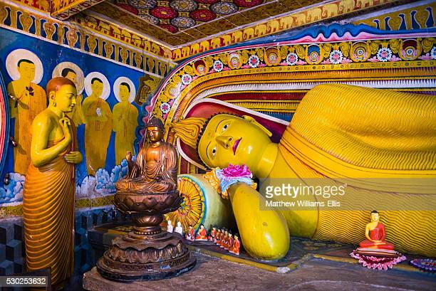 golden reclining buddha at temple of the tooth (temple of the sacred tooth relic) in kandy, unesco world heritage site, sri lanka, asia - dalada maligawa stock photos and pictures