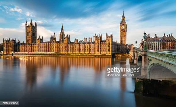golden reflection - houses of parliament london stock pictures, royalty-free photos & images