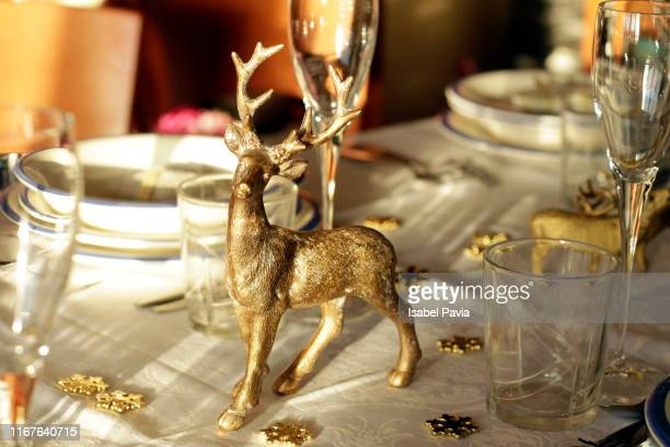 golden reindeer decorating festive christmas table - gold decoration stock pictures, royalty-free photos & images