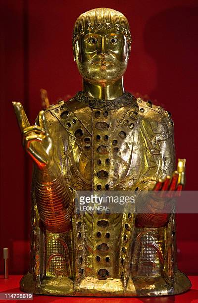 A golden reliquary bust of Saint Baudime is displayed in its case at the British Museum in central London on May 26 2011 The lifesized golden bust of...