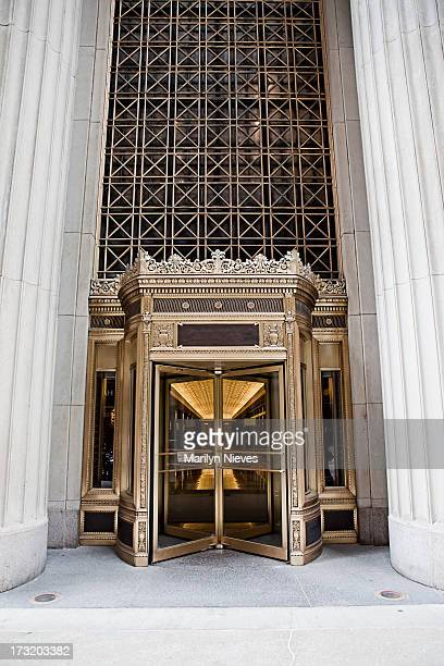 golden revolving doors - revolve stock photos and pictures