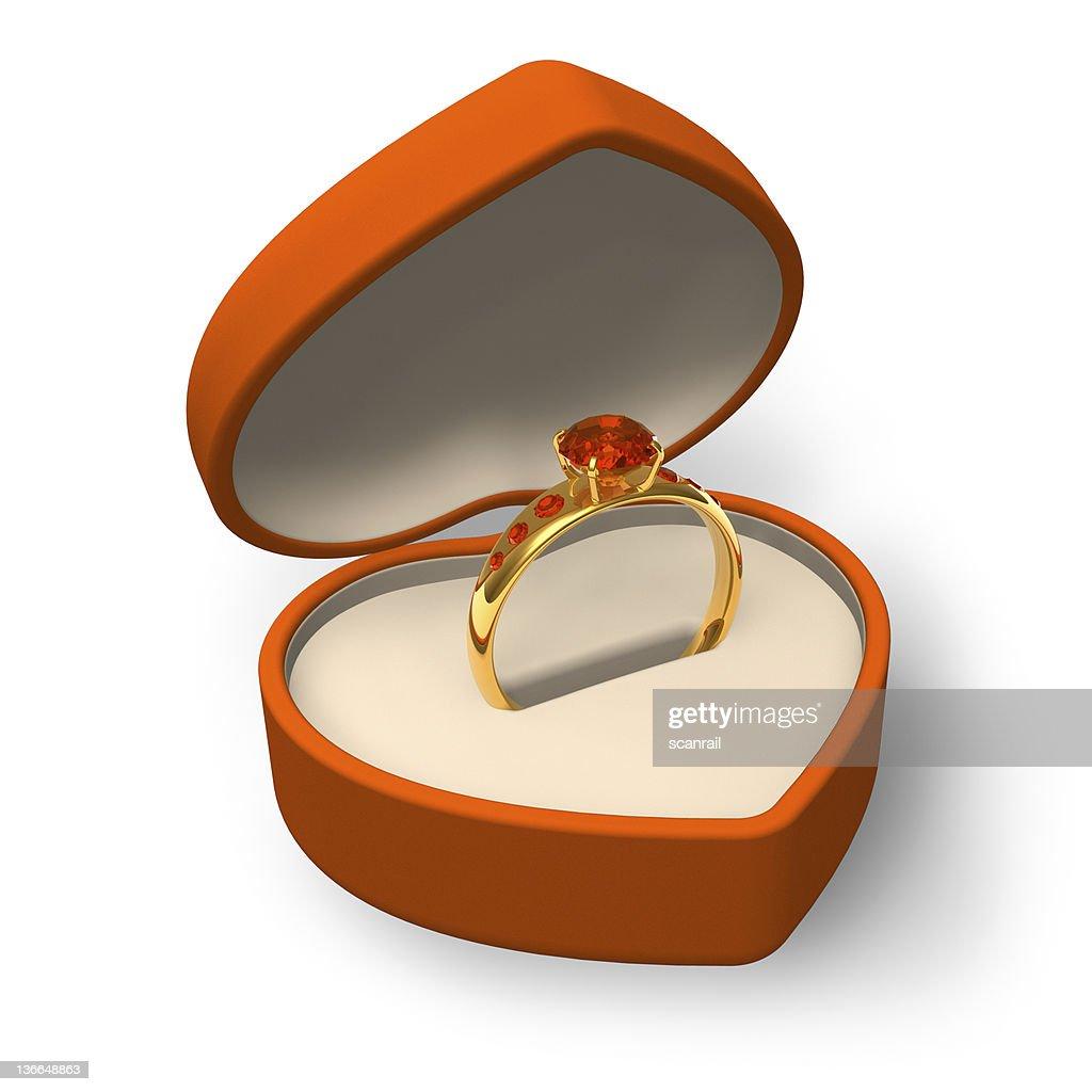 Golden Ring With Jewels In Orange Heartshape Box Stock Photo ...