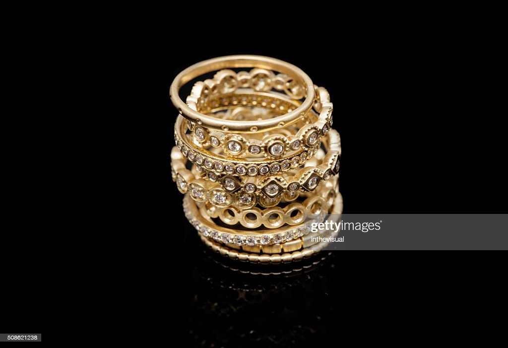 Golden Rings Collection on Black Background : Stock Photo