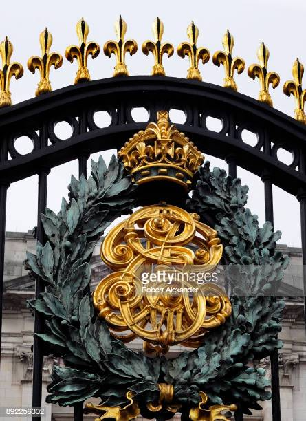 Golden royal crest of King George decorates the entrance gates leading into Buckingham Palace in London England
