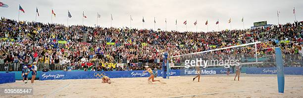 VOLLBEACHBALLG Golden sands golden moment Kerri Pottharst drops to the sand sobbing with joy as teammate Natalie Cook rushes to embrace her after the...