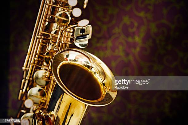 Golden saxophone gleams against a background of richly figured silk