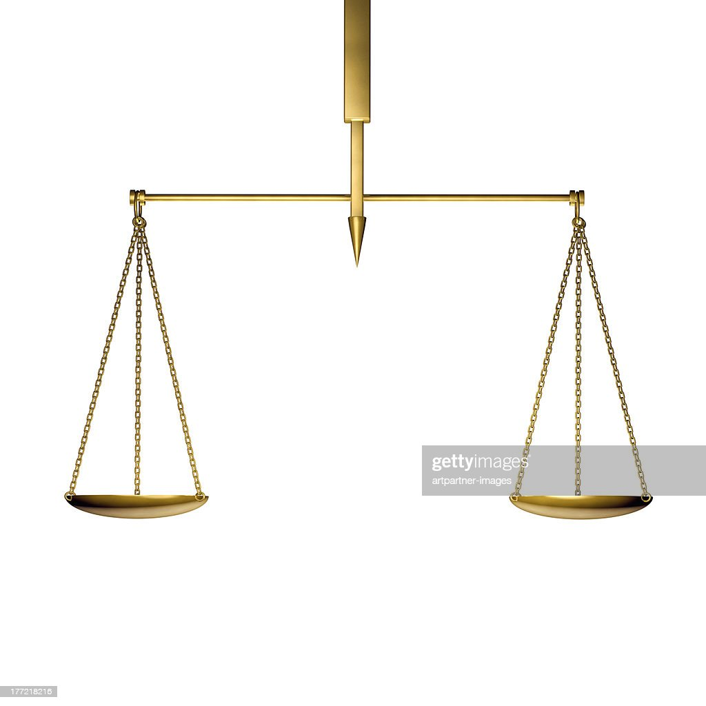 A golden scale in balance on white : Stock Photo
