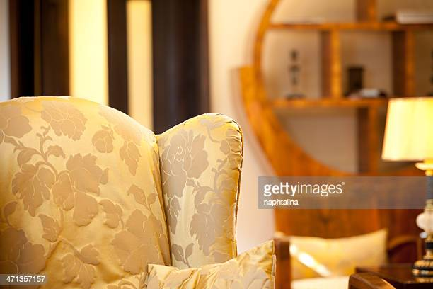 Golden seat in antique room