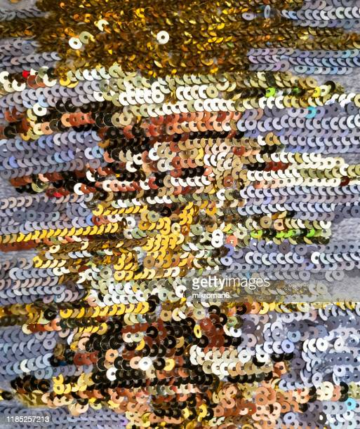 golden sequins texture background. - bead stock pictures, royalty-free photos & images