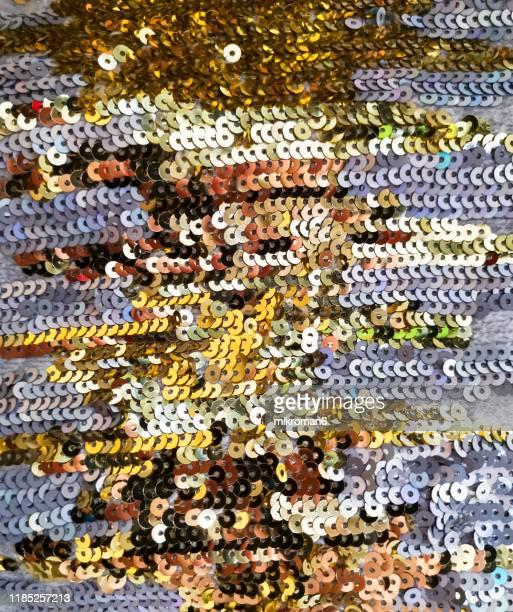 golden sequins texture background. - perlenschnur stock-fotos und bilder