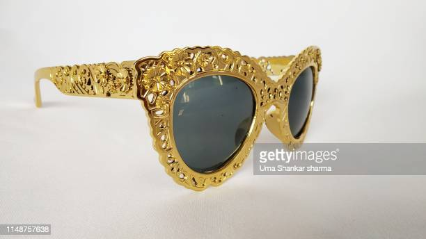 golden shades with embroidered frame - golden goggles stock pictures, royalty-free photos & images