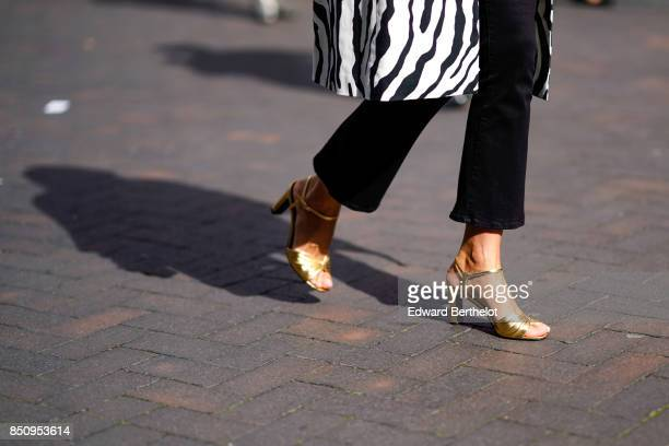 Golden shoes are seen outside Roland Mouret during London Fashion Week September 2017 on September 17 2017 in London England