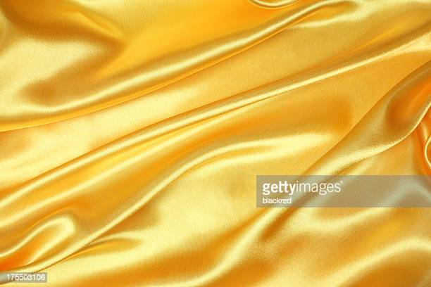 golden silk texture - silk stock pictures, royalty-free photos & images