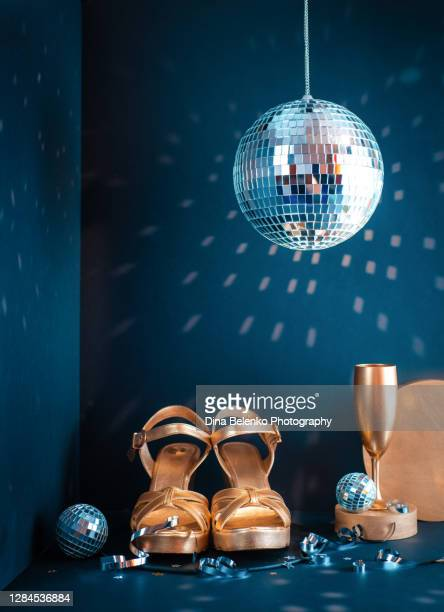 golden slippers, disco ball, champagne glasses and glitter on a dark - gold shoe stock pictures, royalty-free photos & images