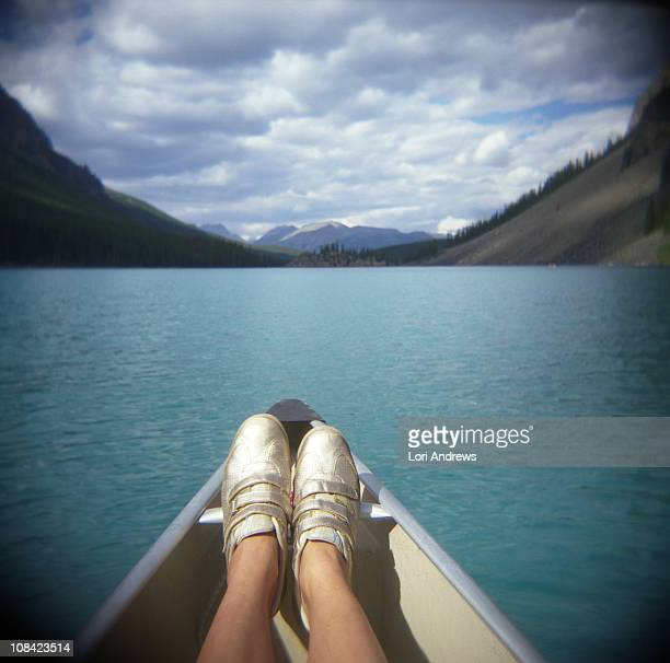 golden sneakers and an azure mountain lake