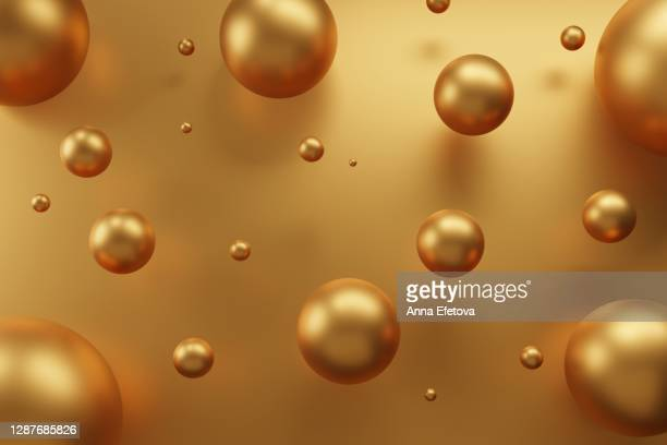 golden spheres on metallic background. new year ornaments concept. festive abstract background. - christmas bauble stock pictures, royalty-free photos & images