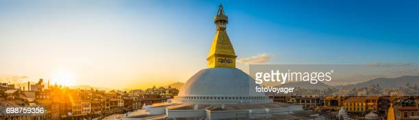 Golden spire Buddhist stupa temple illuminated sunset Boudhanath Kathmandu Nepal