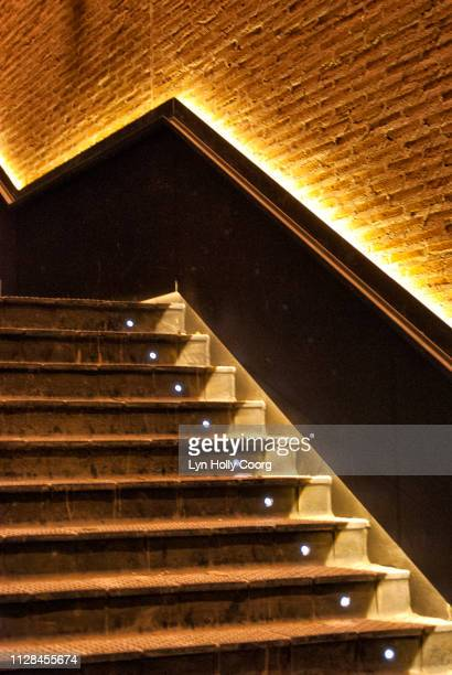 golden stairway lit up at night - lyn holly coorg stock pictures, royalty-free photos & images